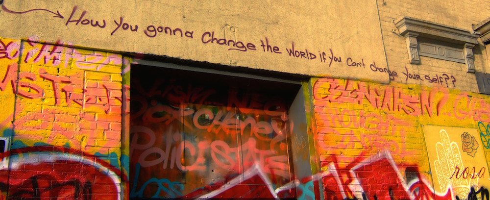 Painted wall with the text How you gonna change the world if you can't change yourself?